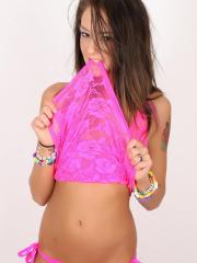 Spunky babe Sierra teases in her skimpy pink lace tank top that barely covers her perky boobs