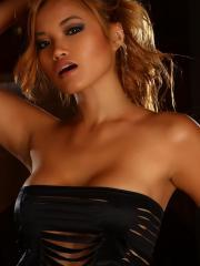 Stunning tease Jannie shows off her perfect body a skimpy little top that barely covers