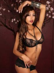 Stunning babe Jenna C teases with her big tits in a skimpy black lace almost sheer bra