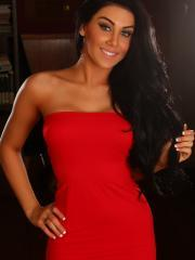 Beautiful tease Danielle shows off her perfect body in a tight red dress