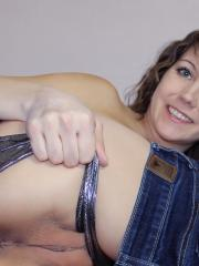 Andi Land slides down her jeans to show you her round ass and tight pussy