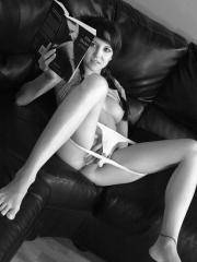 Pictures of Andi masturbating on the couch in black and white
