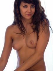 Teen hottie Andi Land gets completely nude and shows off her hot body
