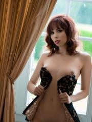 Ariel Rebel strips in her vintage style corset
