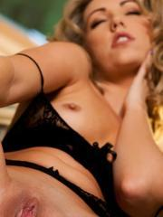 Blonde beauty Sarah Peachez spreads her legs for you in beautiful black lingerie