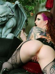 Penny Poison gets off with a glass cross by a gargoyle