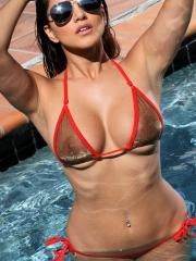 Sunny Leone flaunts her hot body wearing a sheer gold and red bikini in the pool