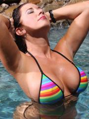 Jayden James uses her big boobs as floatation devices in the pool