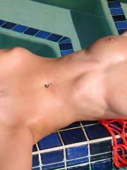 Carli Banks slips out of her orange micro bikini in the pool