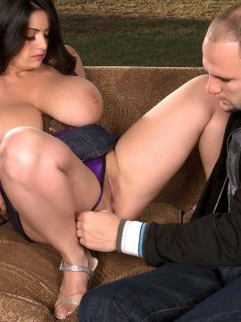 Curvy girl Arianna Sinn putting her huge tits and ass to good use