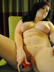 Chubby girlfriend strips naked and plays with a dildo