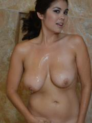 Big breasted babe Mai Ly teases with her huge tits in the shower