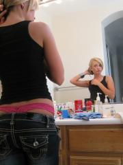 Cute blonde teen Codie Sweets shows off her perfect ass in tight jeans as she gets ready to shoot