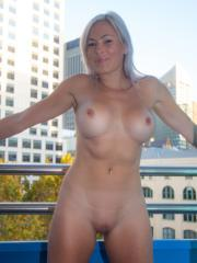 Busty blonde KJ Stone shows you her curvy nude body in her first set