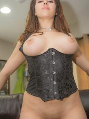 Busty brunette Rachel Lancaster shows you her big boobs in a black corset