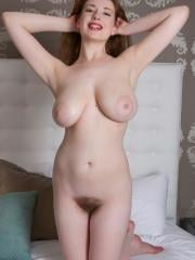 Busty redhead Misha Lowe gets naked for you on the bed
