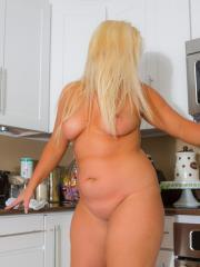 Curvy blonde Amanda Clark strips for you in the kitchen