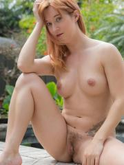 Redhead girl Ivy Jane strips for you outside