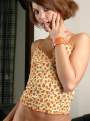 Cutie Diddylicious teases in her orange flower tank-top and panties