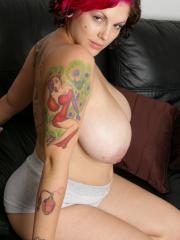 Big tit star Dors relaxes on the sofa in her shorts tshirt and socks
