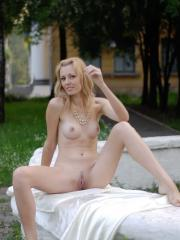 Blonde hottie Alina Porter spreads her legs by the fountain