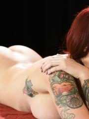 Inked redhead babe Tana Lea gives the best massage ever