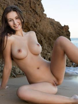 Alisa I shows her gorgeous nude body on a beach in Stranded