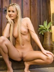 Pictures of hot blonde Jana E showing her naked body