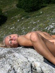 Pictures of blonde beauty Hella exposing her hotness outside
