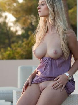 Pictures of blonde bombshell Carisha exposing her super hot body outside