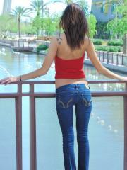 Skinny brunette teen Jody strips out of her clothes and exposes her tight body in public