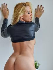 Blonde girl Vega lifts her skirt and spreads her wet pussy