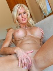 Blonde babe Jewel shows you her big tits and wet pussy