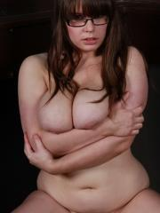 Curvy Georgina loves teasing by playing with her big boobs in her tight satin bra