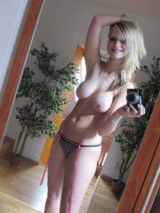 Pictures of a gorgeous busty blonde girlfriend taking pics of herself