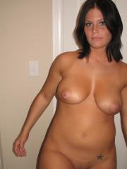 Curvy girl next door Whitney shows off her big tits and round ass completely naked