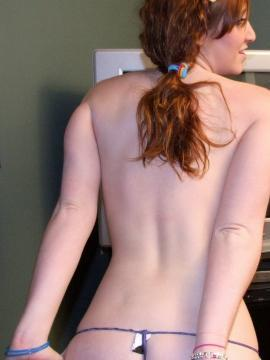 Ruby isnt shy as she strips out of her skimpy red tube top teasing with her perky tits