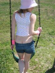 Teen girl Shelby teases with her perky perfect tits at the playground