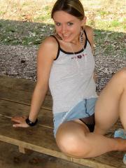 Cute blonde teen Shelby teases at the public park in her skimpy little outfit