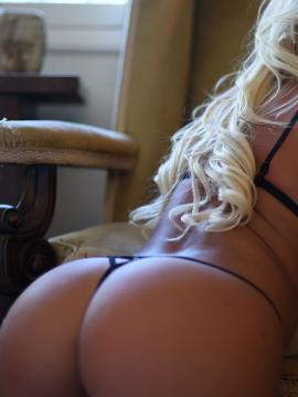Gorgeous blonde Stacey Robyn teases in her string bikini