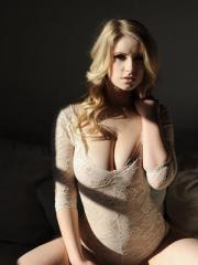 Jess Davies looks sultry in her pretty white top which she pulls down to reveal her incredible boobs