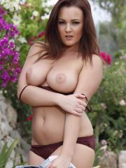 Busty brunette Jodie Gasson exposes her big boobs for you outside