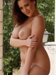 Sexy girl Jodie Gasson shows you her tits outside