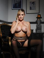Busty girl Jodie Gasson shows off her big natural boobs in black lingerie