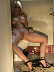 Pictures of Kagney Linn Karter playing with her pussy on the toilet
