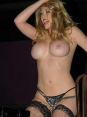 Pictures of Kagney Linn Karter working the stripper pole for tips