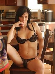 Pictures of Karen Dreams slipping out of her black bra and panties
