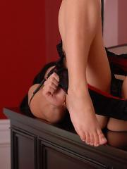 Pictures of Karen Dreams teasing in red and black lingerie