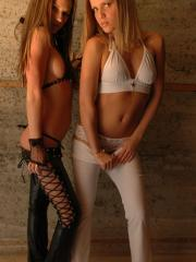 Hot teens Karen and Kate poses in their white and black outfits