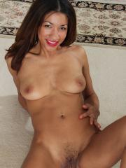 Ebony girl strips nude and shows you her trimmed pussy